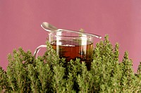Glass with herbal tea and thyme (thumbnail)