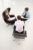 Three office workers in a meeting