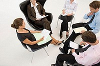 Five office workers in a meeting