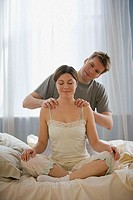 Husband massaging wife