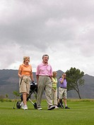 Golfers walking on course
