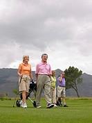 Golfers walking on course