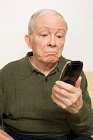 Elderly man with remote control