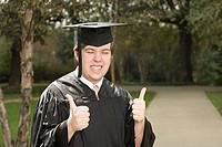 Male graduate giving thumbs up