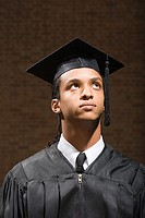 Male graduate looking up
