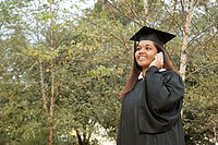 Female graduate using a cellular phone