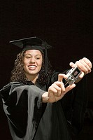 Female graduate taking a self portrait