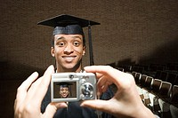 Male graduate having his photograph taken