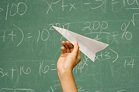 Student about to throw paper aeroplane