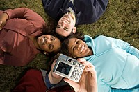 Four students taking a photograph outdoors