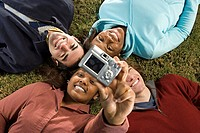 Four students taking a photograph