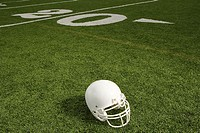 Helmet on american football field (thumbnail)