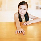 Girl leaning on counter