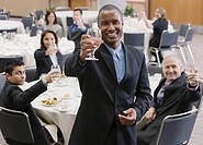 Businessman making a toast at lunch