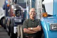 Middle aged man smiling beside his truck (thumbnail)