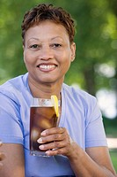 Middle-aged woman drinking a soda