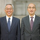 Two Asian businessmen posing