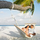 Couple sleeping in a hammock