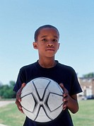 Portrait of boy holding soccer ball