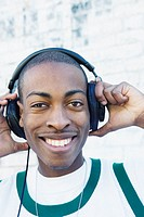 Teenage boy wearing headphones