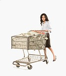 Businesswoman pushing shopping cart full of money