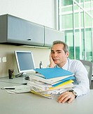 Stack of papers on businessman's desk
