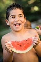 Portrait of a boy holding a slice of a watermelon (thumbnail)