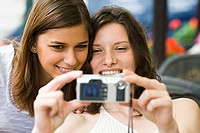 Two teenage girls taking a picture together (thumbnail)