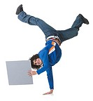 Portrait of a teenage boy holding a blank sign and doing handstand (thumbnail)