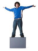 Portrait of a teenage boy standing on a blank sign and smiling (thumbnail)