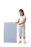 Portrait of a young girl holding and pointing at a blank sign (thumbnail)