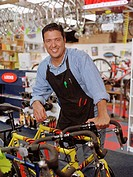Bicycle salesman smiling for the camera