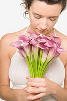 Young woman smelling a bunch of flowers