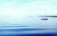 Sailboat moored in morning mist