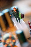 Close-up of the figurine of a businessman with a briefcase on a circuit board