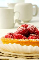 Close-up of a strawberry tart in a plate