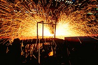 Hot saw cutting steel beams, Illinois, USA