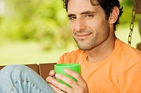 Portrait of a mid adult man holding a coffee cup