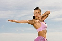 Side profile of a mid adult woman exercising