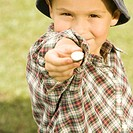 Close-up of a boy holding a candy