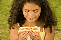 Close-up of a girl holding a sandwich