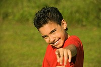 Portrait of a boy pointing forward