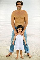 Portrait of a father and his daughter on the beach