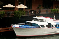 Tour boat moored in front of a restaurant, Chicago, Illinois, USA