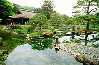 Reflection of trees and rocks in a lake, Katsura Imperial Garden, Katsura Imperial Villa, Kyoto, Japan