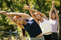 Three young women stretching in tree pose