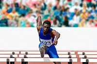 Male Runner Clearing a Hurdle