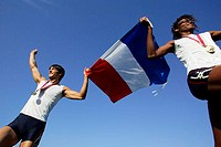 Male Runners Carrying French Flag