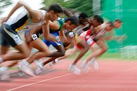 Male Runners Leaping Off Starting Blocks