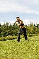 Young woman practicing martial arts